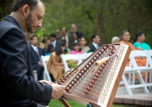 doug-berch-playing-hammered-dulcimer-seated-and-looking-good